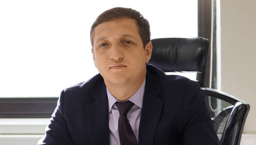Roman Bogdashkin, Director of Enterprise Applications  <br> and e-Business Development in Air Astana